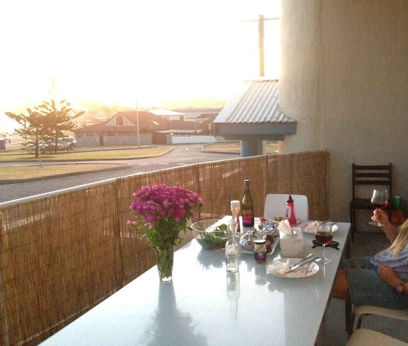 Balcony dining table at sunset