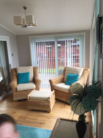 Sun room , with patio door directly onto the decking .
