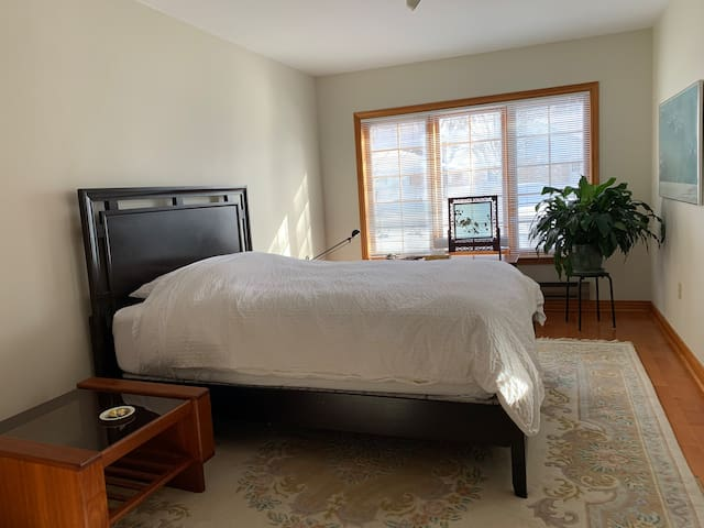 Spacious upper level bedroom with queen sized bed