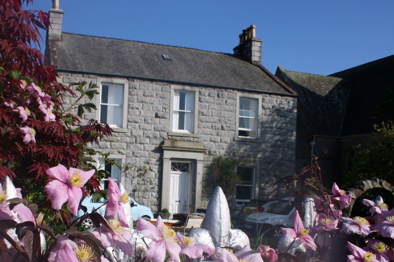Newton house in spring sunshine