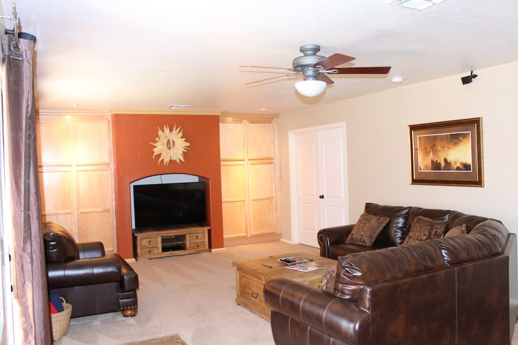"""Family Room with 55"""" TV Cable Television Blu-Ray Player Surround Sound & Ceiling Fan"""