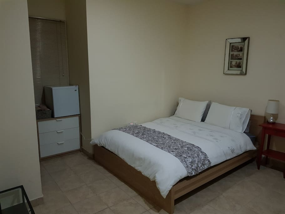 Double bed, fresh linen and towels, plus room cleaned for guests staying longer than two weeks.