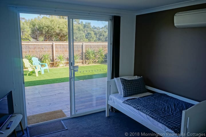 2 single beds in the 2nd bedroom with access to your private yard