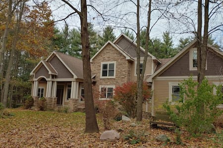 Spacious family home on rolling wooded acres