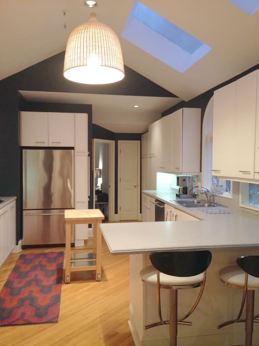 Spacious, well-stocked kitchen with modern appliances