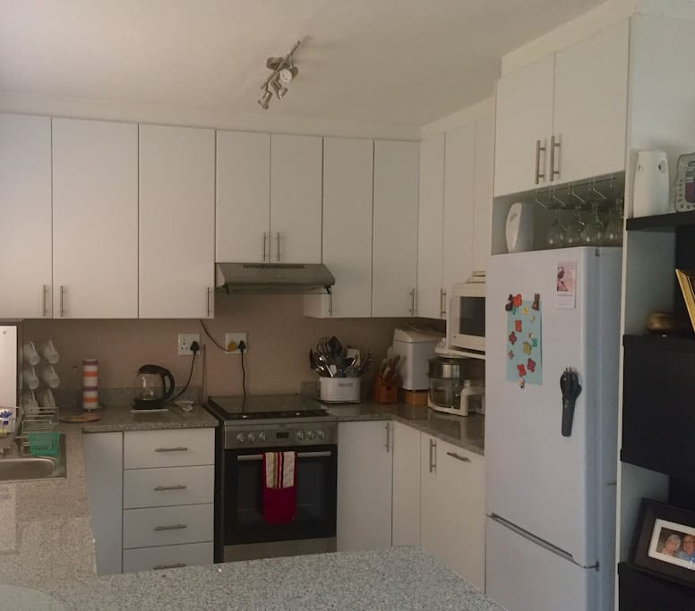 Open planned kitchen with dishwasher, gas stove and all  kitchen amenities