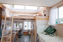 Double bed loft with pop-up hatches for star gazing; single sleeping settee