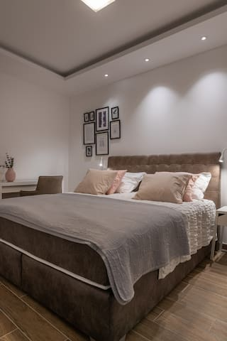 Bedroom 1 with extra large boxspring bed