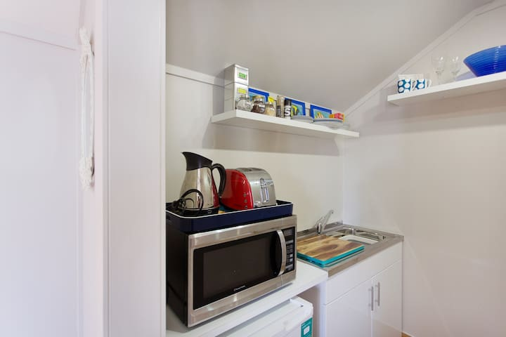 Kitchenette with basic cooking requirements.
