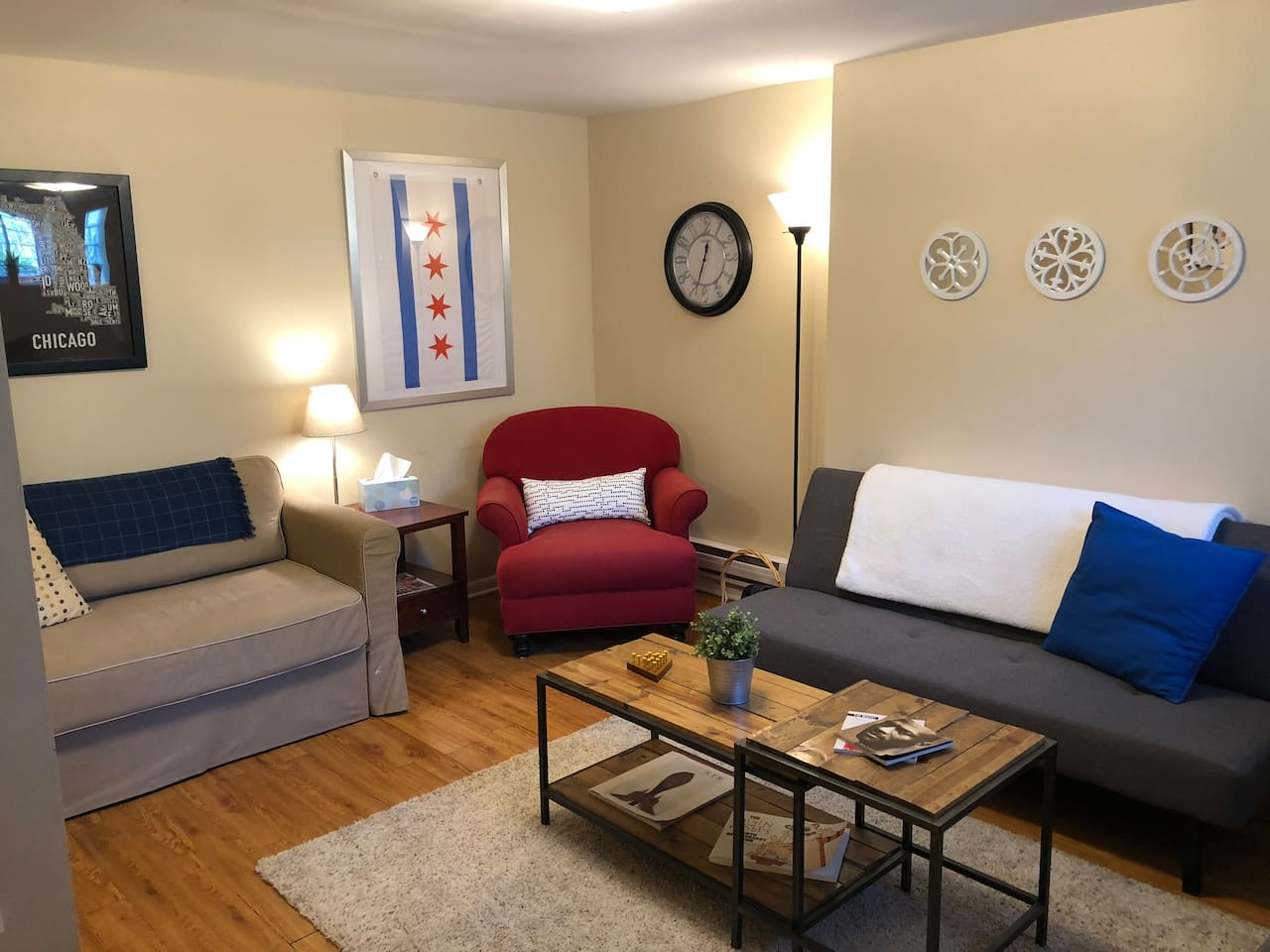 Living room with IKEA bed that converts into a twin bed and a small futon