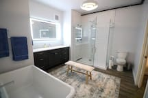 Large master bath featuring Subway Tile Shower