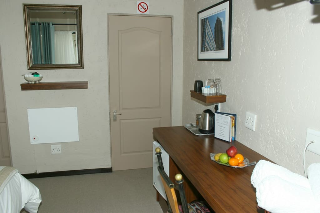 Room 4, large built in cupboard and desk