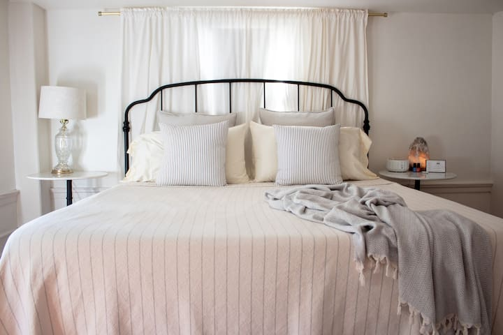 Room #1: The King Room - king size bed/2 guests. Organic/eco mattress, organic bamboo mattress pad, natural linen sheets and blankets. Natural fill pillows in assorted firmness.