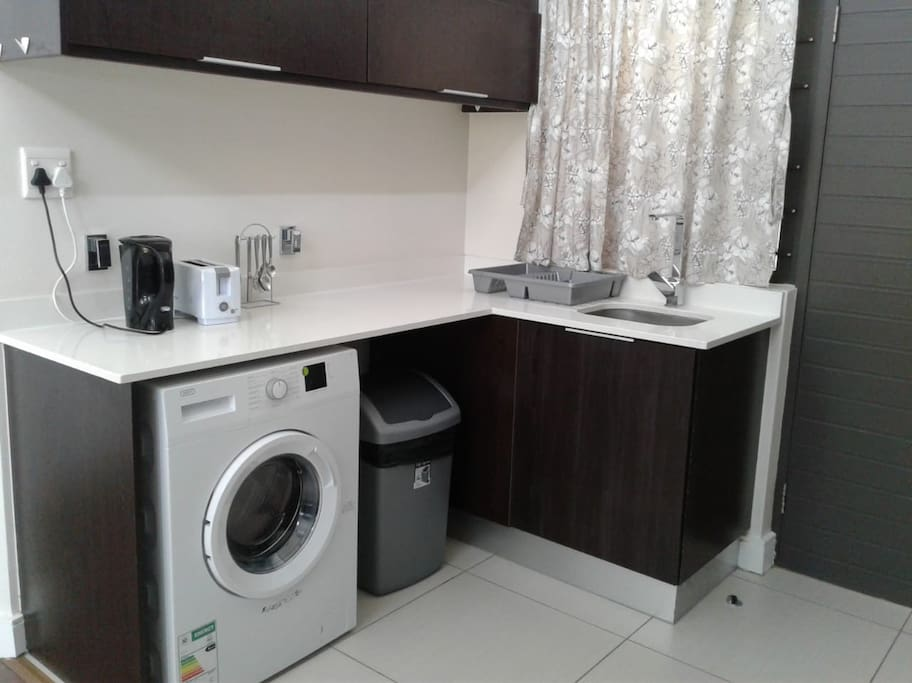 Kitchen area (washing machine, kettle, toaster)