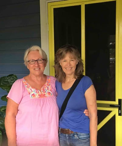 Welcoming guest is always a delight at our canary yellow front door