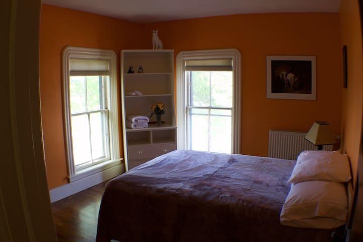 Orange Room - Full Bed - (Medium) - North and East Facing Windows