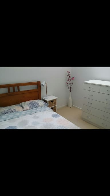 Bedroom 2. Double bed with set of drawers. Beautiful skylight window in ceiling and ceiling fan.