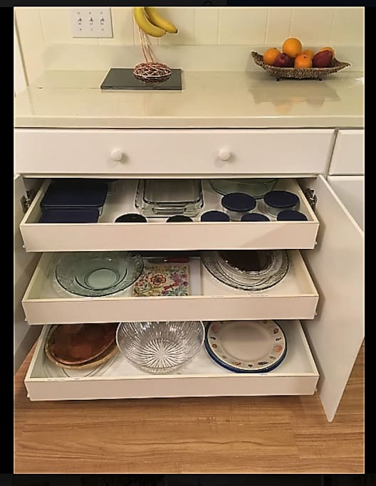 Your Buffet/Sideboard has these wonderful pull-out shelves that houses every serving dish imaginable! Shelves are labeled for an easy clean-up when putting away the dishes.