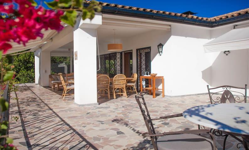Villa with pool, garden, and fantastic sea views.