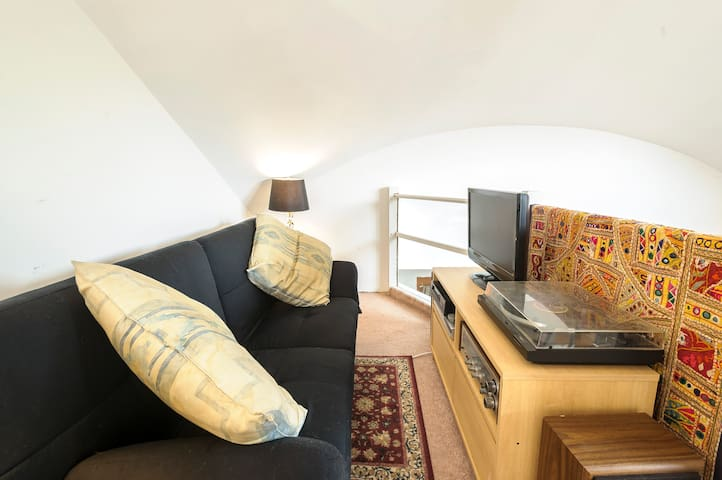 Upstairs loft has TV viewing area and pull out futon couch to accommodate extra adult or child (>10 years old).