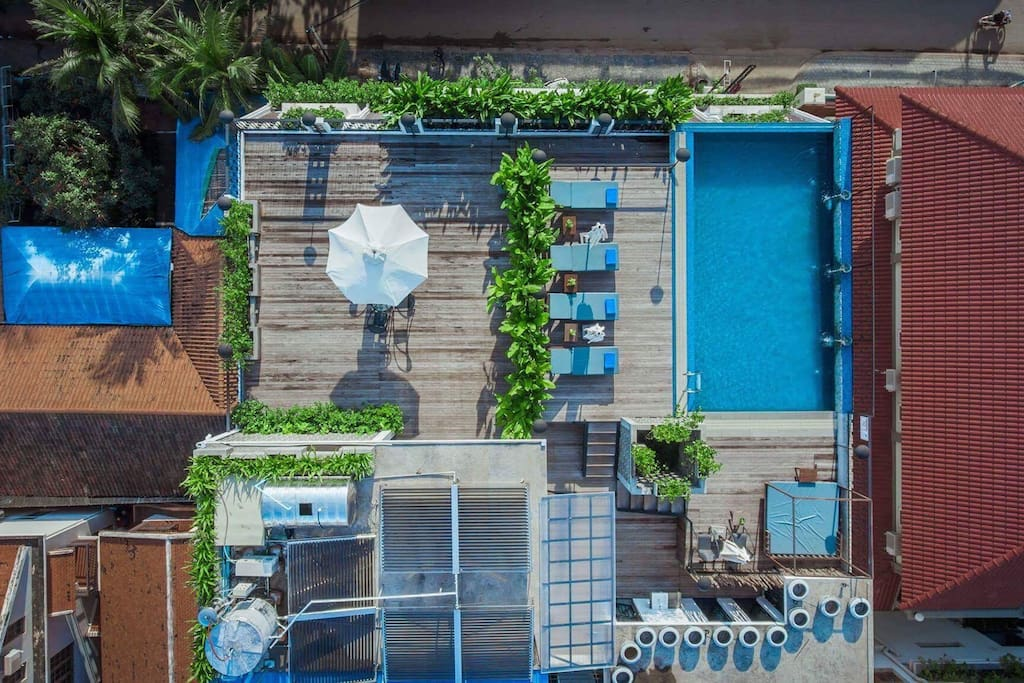 A swimming pool on the roof top with a standard gym.