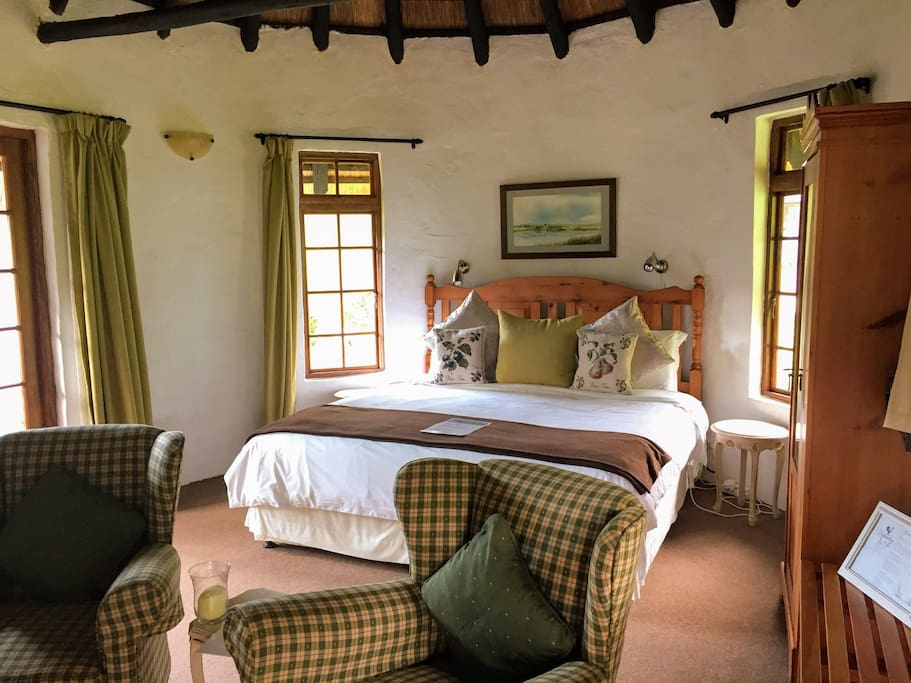 King Sized bed, seating area next to fireplace, tea and coffee facilities