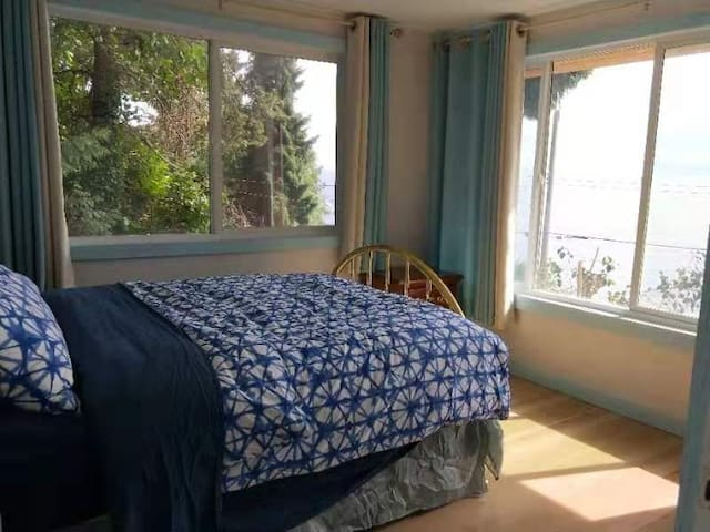 Front bedroom has a very comfortable double bed and 2 views of the ocean and Vancouver Island