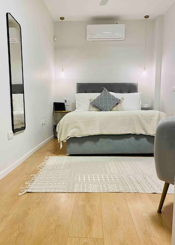 Cosy spacious bedroom. Equip with USB points on either side of the bed,  brand new ceiling fan and  air-conditioning/ heating unit.
