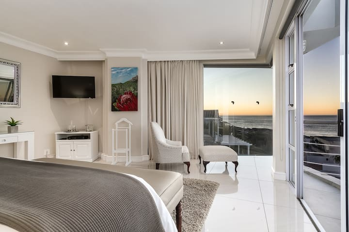 Beautifully spacious Master bedroom, with spectacular ocean and mountain views.
