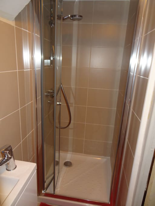Shower room recently  refurbished new shower, sink and toilet, rebuilt walls and new pipework