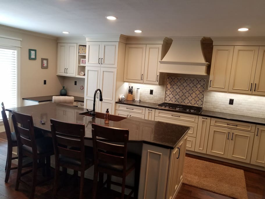 Open to living, kitchen includes workspace