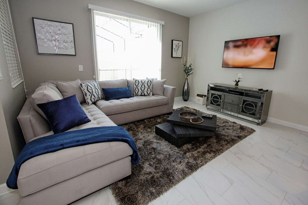 Living Area w/Comfortable Furniture and Flat Screen TV - View #3