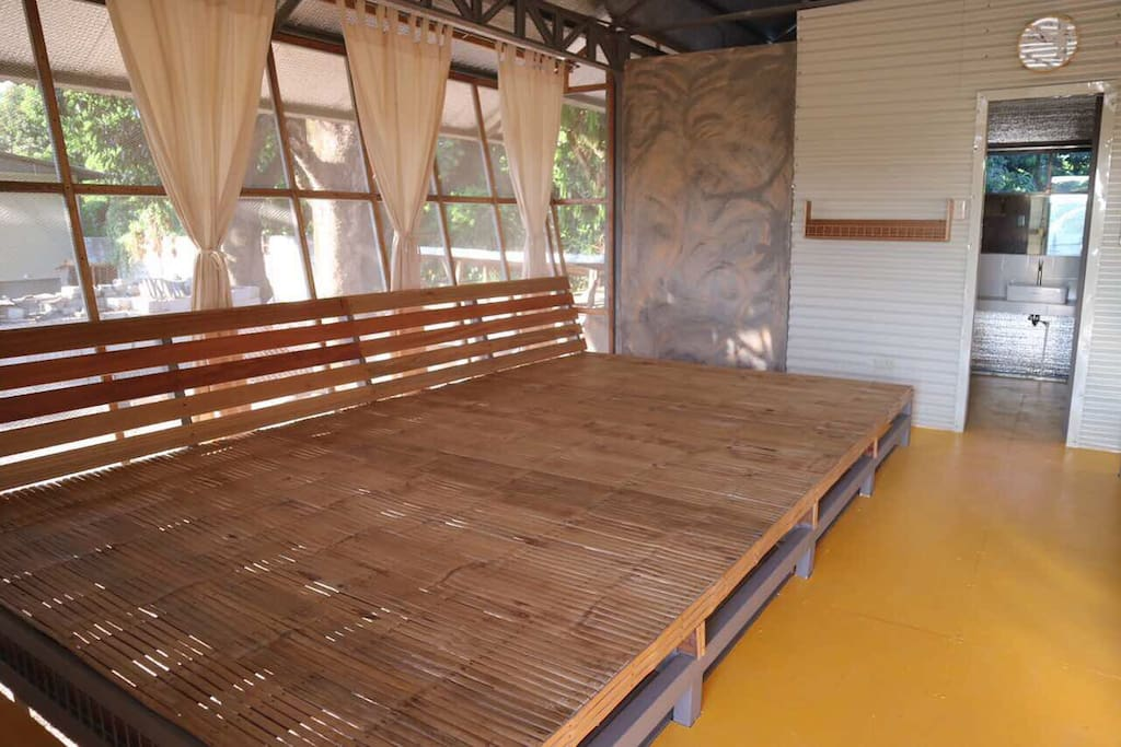 Each brooder house has 2 communal beds made of fine bamboo wood. Each side can sleep 6-7 people.Comfortable to rest and sleep on after the day's activities.