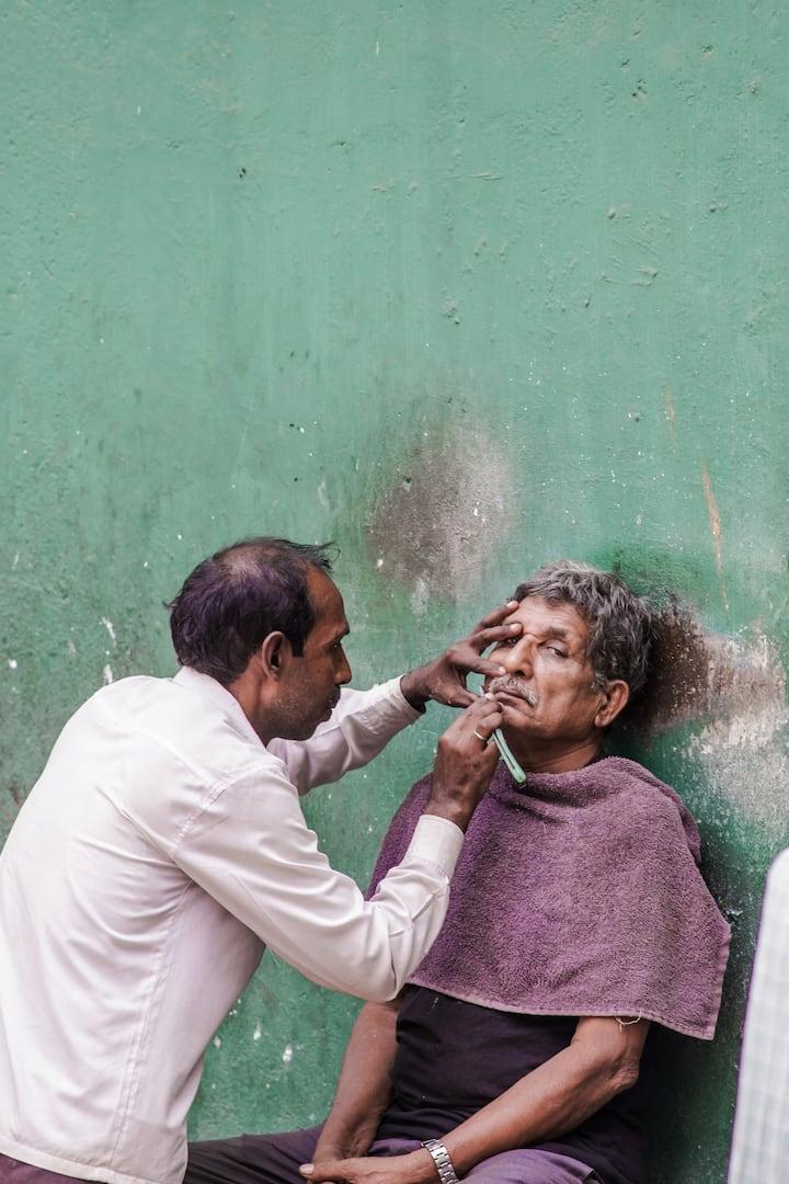 Street barber. India