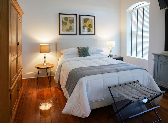 Spacious private rooms offer plenty of sitting area, natural light, and comfortable bedding.