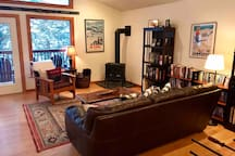 The great room has a cozy gas fire place for winter stay or cool mountain summer mornings.