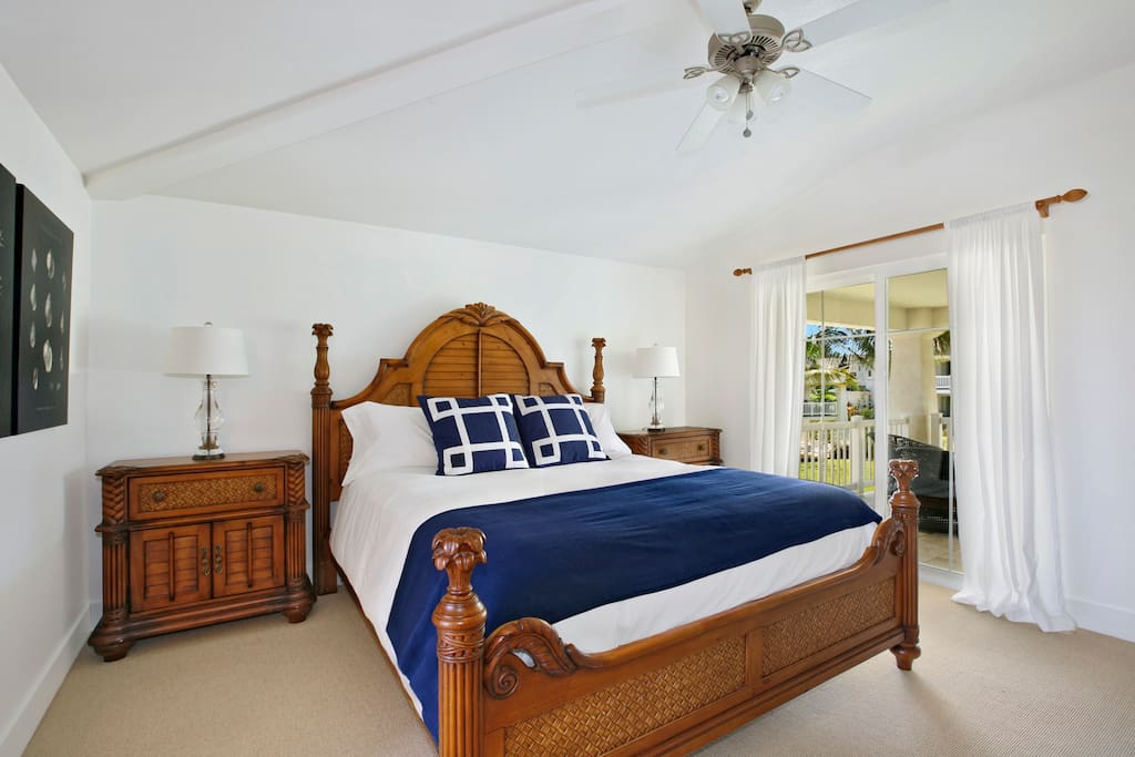 Master bedroom features a king bed with beautiful commercial linens