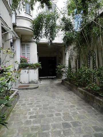 Outside   Here is the courtyard of the building. The apartment is close to the Luxembourg Garden.