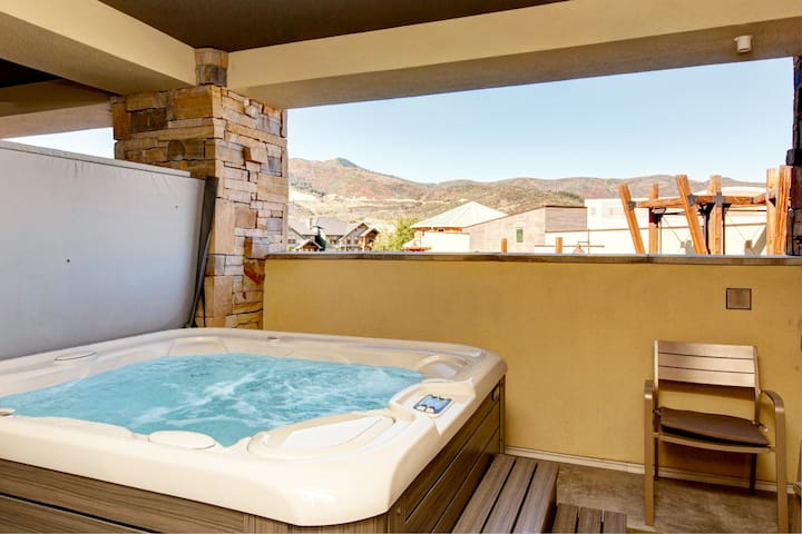Take in mountain views as you soak in the private hot tub.