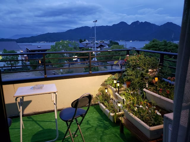 View at night from the common balcony. You can view the sunrise with Miyajima from the common balcony!