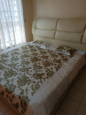 Master bedroom with king size bed and air cond