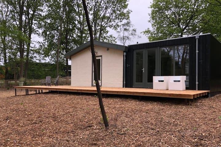 Stijlvolle bungalow nabij prachtige zwempoel