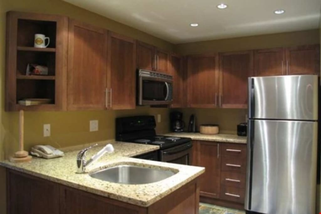 The fully-equipped kitchen comes with everything you need to cook meals in the privacy of your own suite.