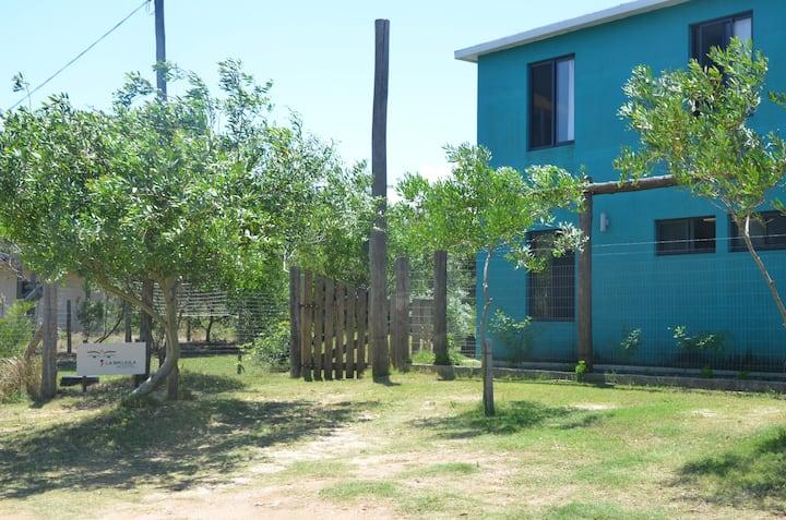 Comunidad y playa La Brujula Hostel