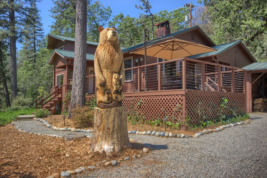 Carved bear by 1,600 square foot cabin welcomes you home as you arrive!