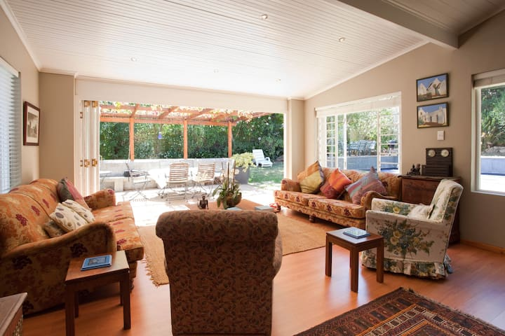 Stacker glass doors open out to covered verandah