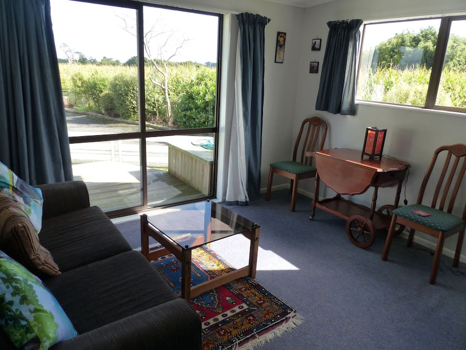 Your own sitting room with TV and Sky, with views to Kapiti Island and your own deck outside.