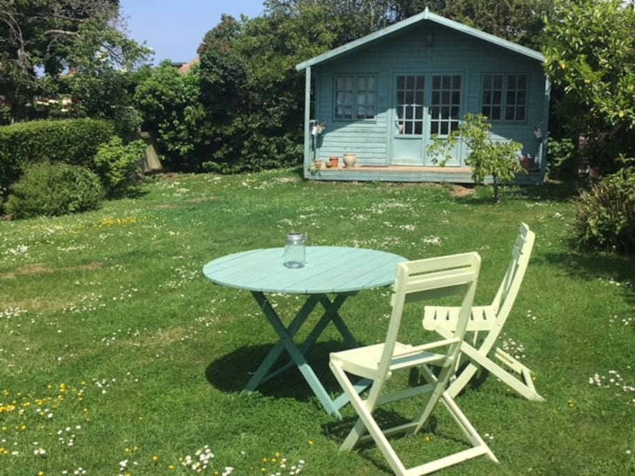 The summerhouse, where Simon writes his plays. You're welcome to have your morning coffee in the garden.