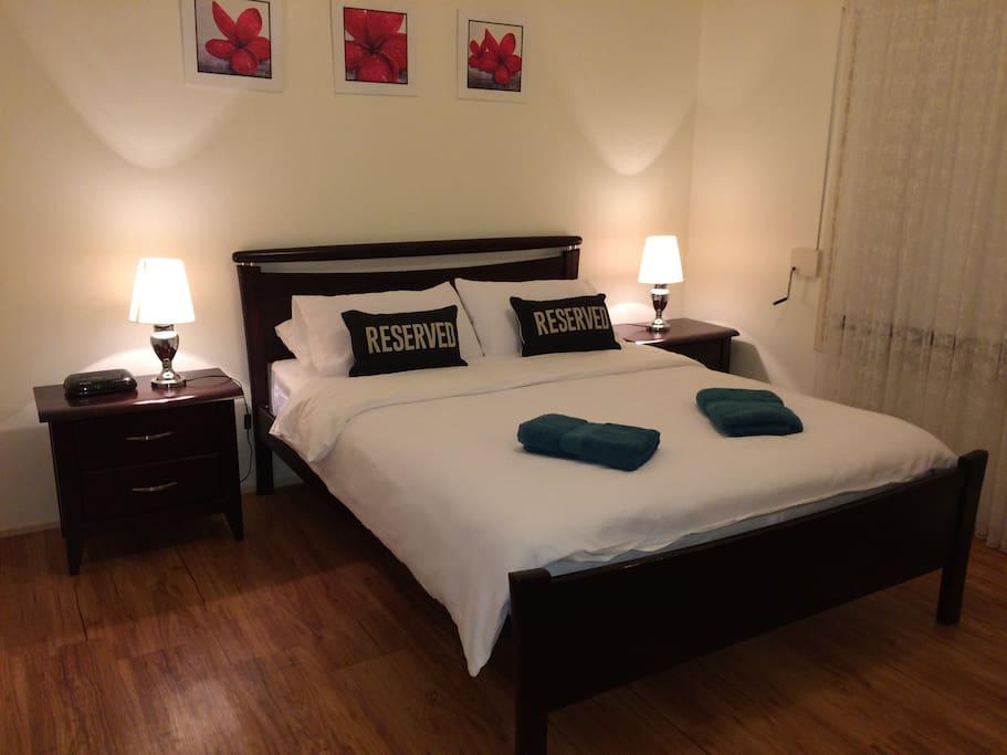 Main bedroom with Queen bed and 2-way bathroom