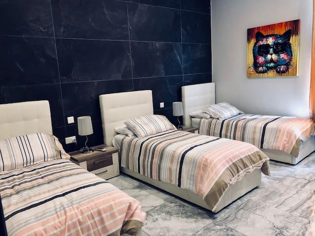 3 single beds bedroom